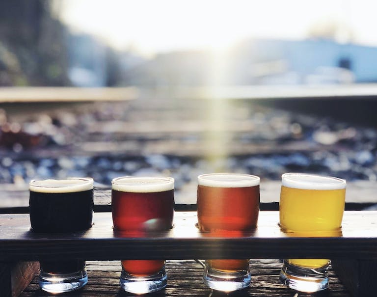 Sun hits a beer flight on the Hi-Wire Brewing Rooftop in South Knoxville